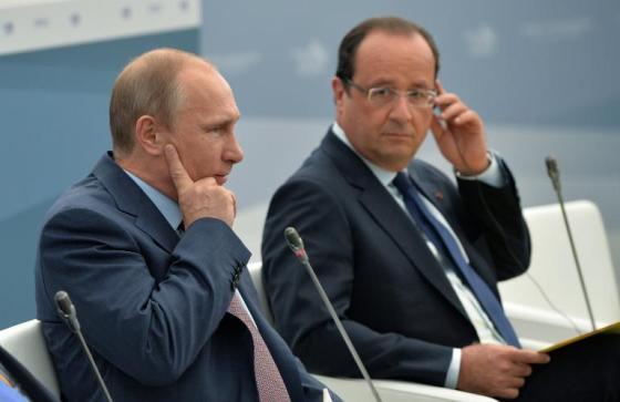 vladimir-poutine-et-francois-hollande-au-sommet-du-g20-le-6_972407